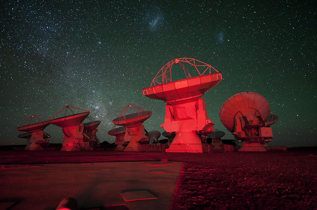 ALMA antennae bathed in red light