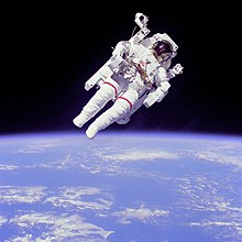 Why are astronauts weightless in space?